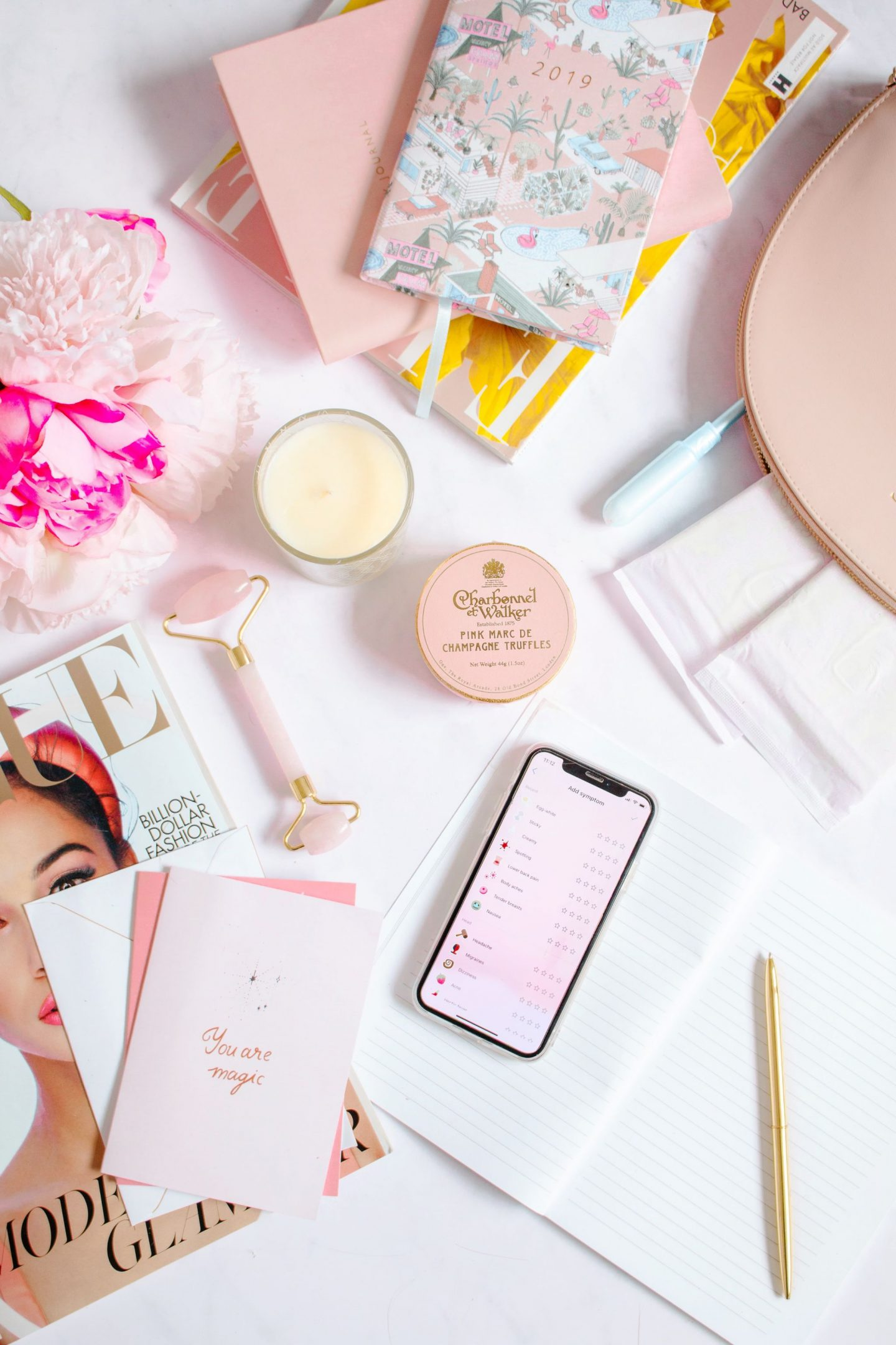 flatlay, pink flatlay, what happens day by day of your menstrual cycle